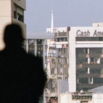 A RadioShack Corporation security guard looks toward buildings that suffered a direct hit from a tornado. The storm killed two people and caused millions of dollars in damage to the downtown Fort Worth area.