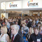 IMEX America attendees wait to get into the event's trade show in Las Vegas.
