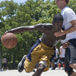 Roderick Johnson drives toward the basked during the Hoop-It-Up Tournament at Fair Park in Dallas, Texas.
