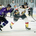 Fort Worth Brahmas defenseman Mike Rusk (#28) tries to beat New Mexico Scorpions right wing Peter Brearley (#11) to the puck.